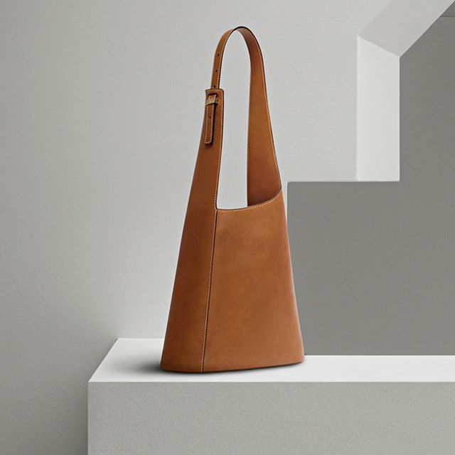 The new Asymmetric Bucket Bag. Now available at victoriabeckham.com and 36 Dover Street, London. #VBPreSS18 #VBDoverSt
