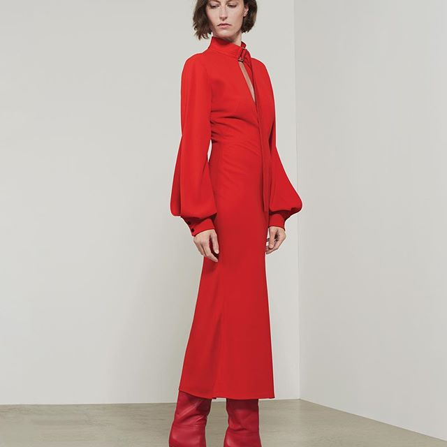 A contrast of toughness and femininity - the slash front midi dress, here with the red heel boot. All available at the link in bio or at #VBDoverSt x VB #VBPreSS19